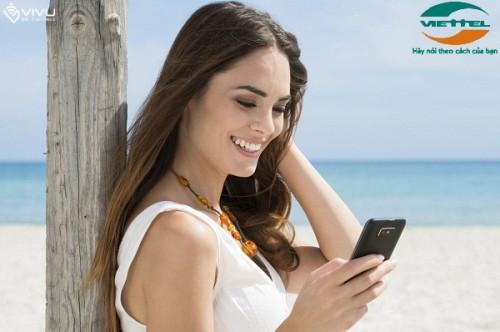 Smiling Girl Reading sms
